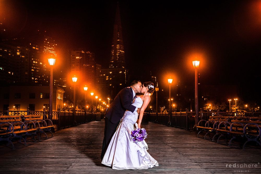 Bride and Groom Kiss at Center of Pier 7, San Francisco Wedding Shoot