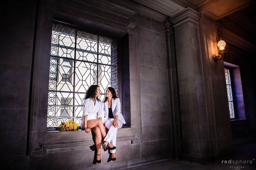 Brides Sitting on SF City Hall Wedding Sill