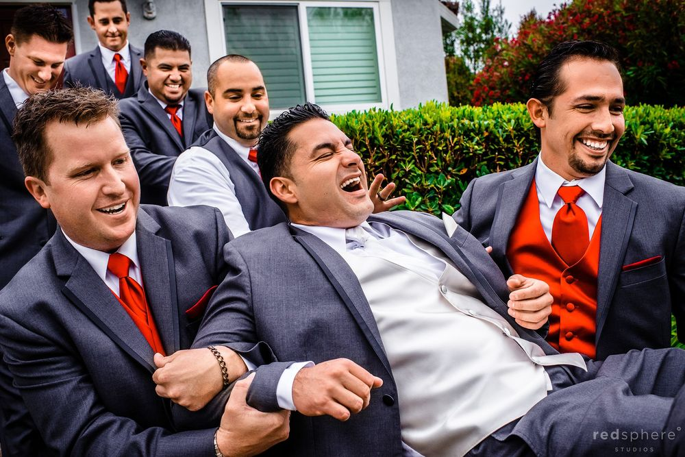 Groom Getting Playfully Carried Out By Groomsmen