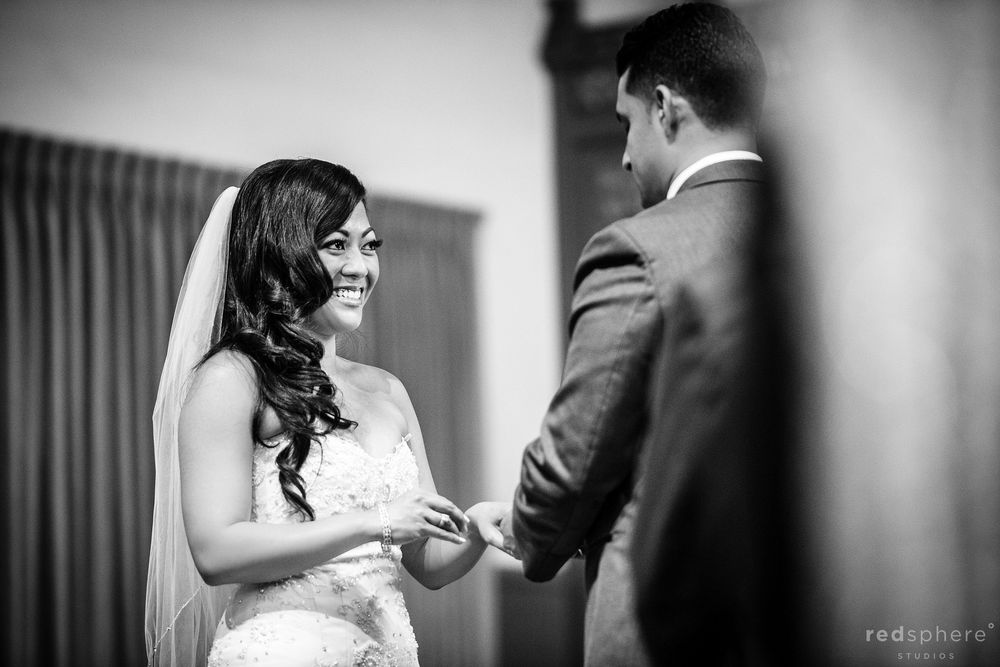 Bride Smiling at the Groom as They Exchange Rings, Black and White