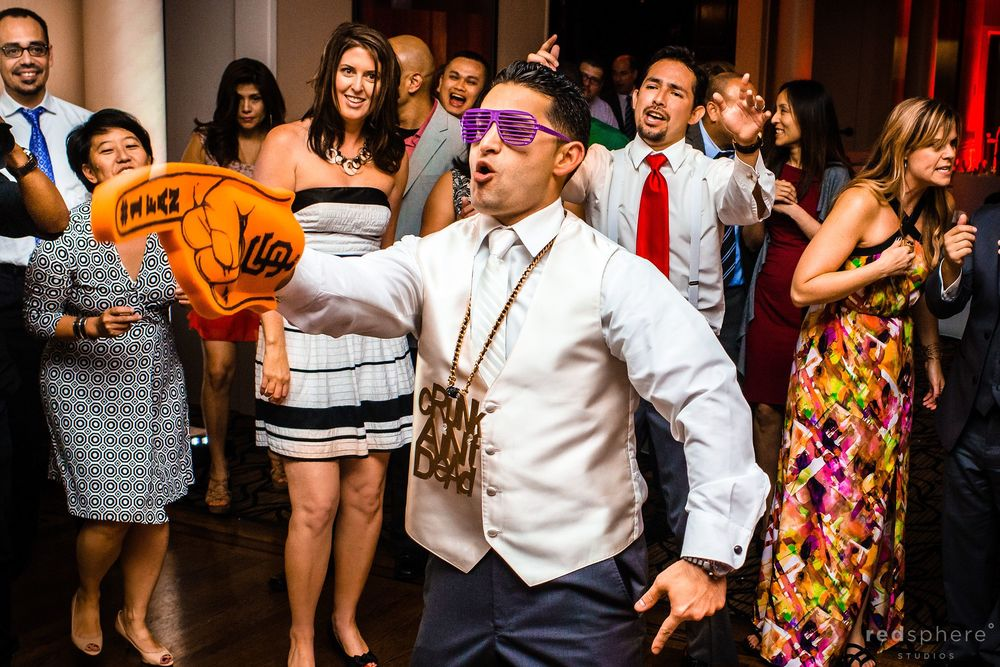Groom Showing His Silly Side With Funky Glasses, Chain Necklace and Giants Foam Finger, Wedding Reception