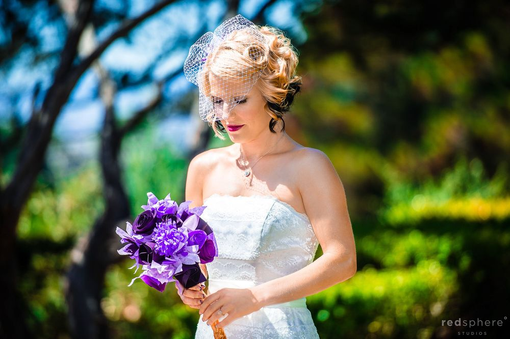 Bride in White Dress With Purple Bouquet of Flowers, Eyes Closed