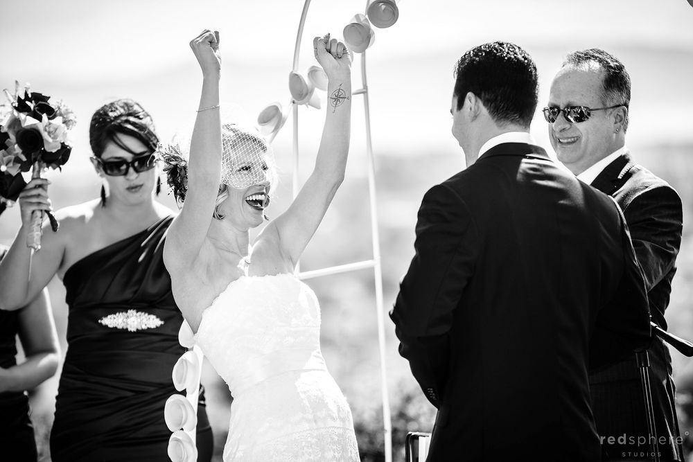 Bride Celebrating As Groom Smiles With Joy, Black and White Candid