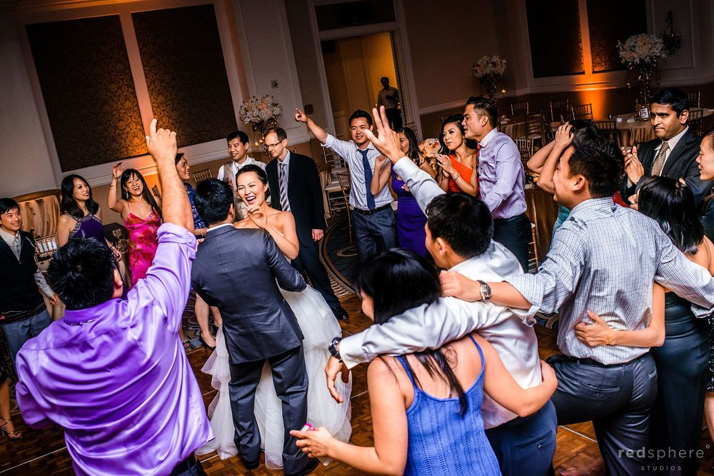 Bride and Groom Share One Last Dance While Guests Celebrate at The Ritz Carlton, Half Moon Bay, CA