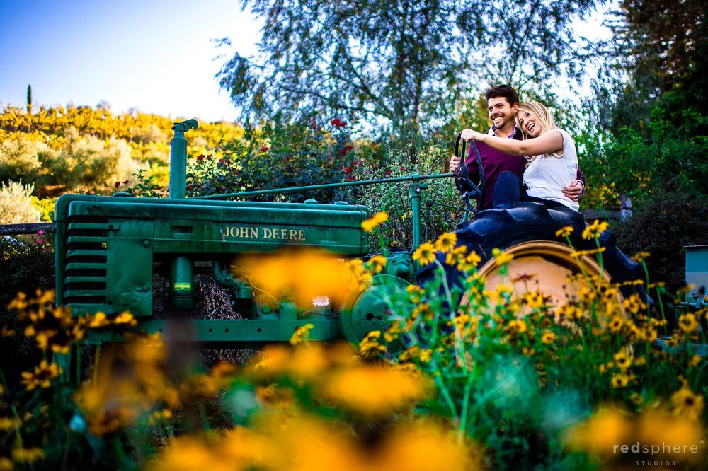 Couple Hug While Sitting on a Tractor, Tulips, Sonoma County Engagement