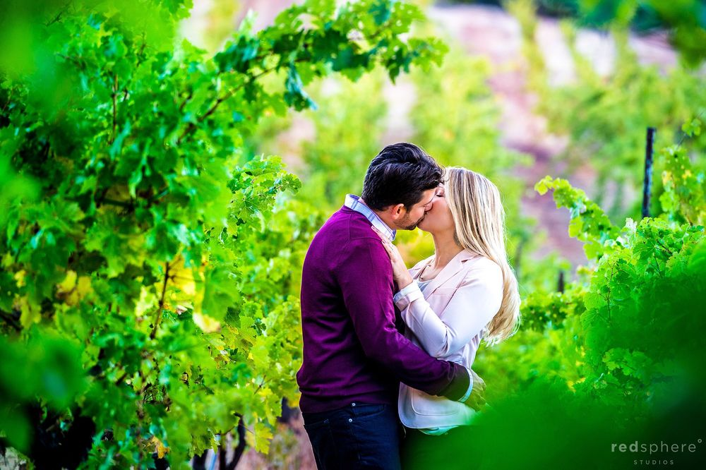 Couple Kiss in Sonoma County Vineyards Engagement