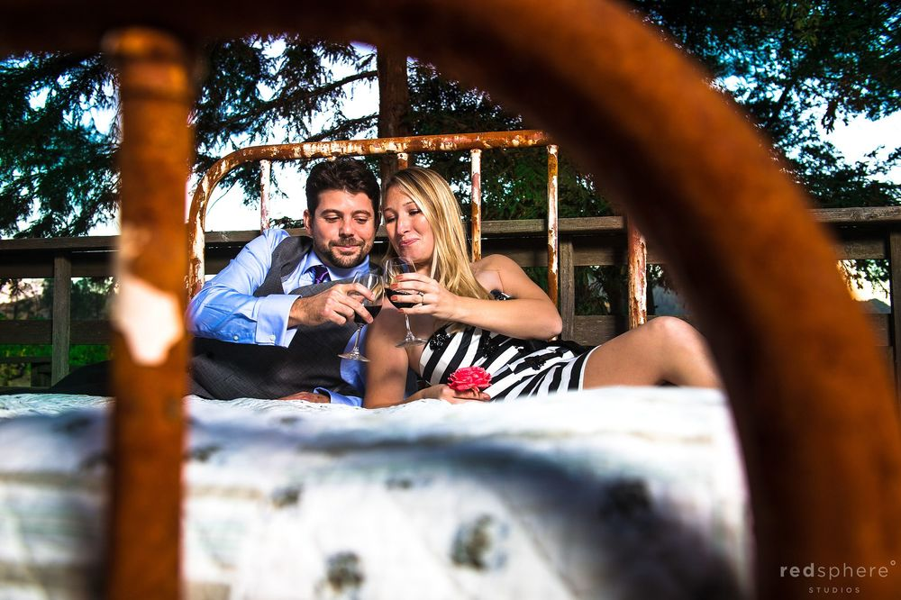 Couple Share Wine on Bed in The Forest, Sonoma Engagement