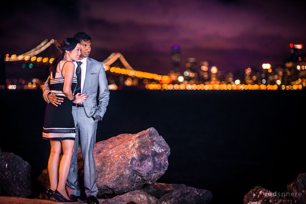 Couple Look Off Into the Distance at Treasure Island, Night Engagement