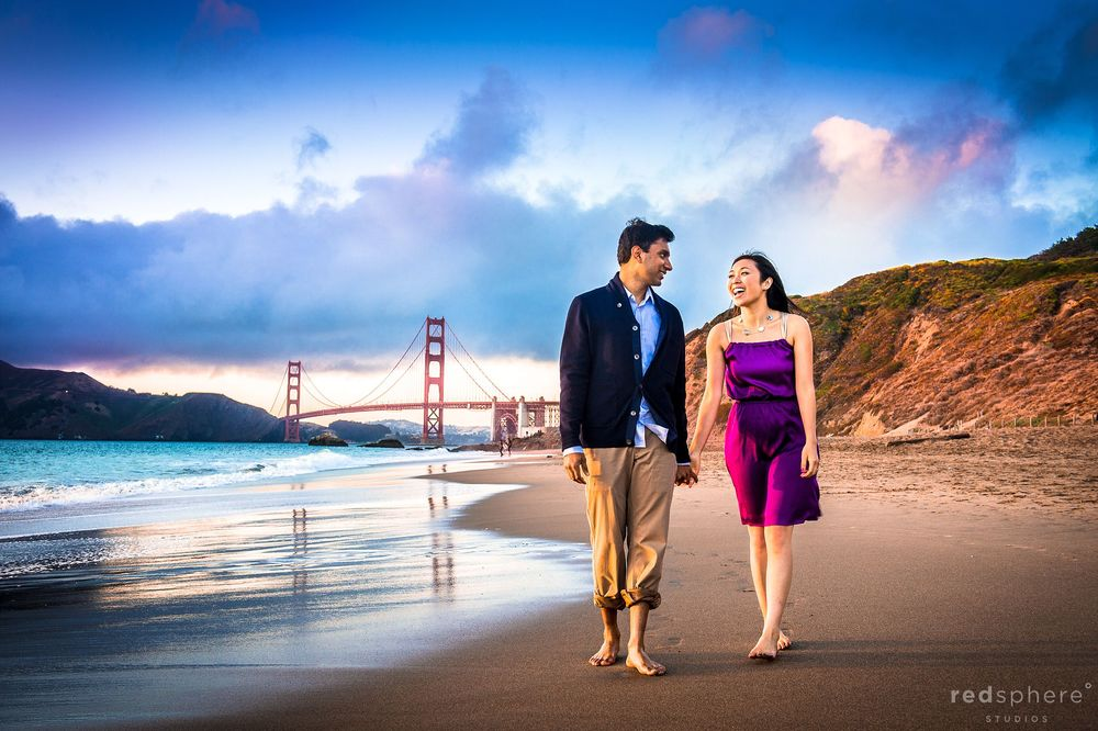 Couple Strolling and Sharing Laughs at Baker Beach Engagement