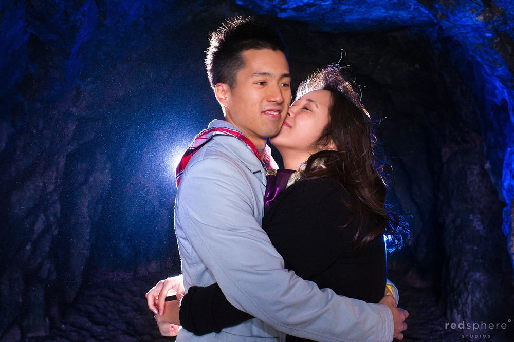 Engaged Couple Hugs in Sutro Bath Caves, San Francisco