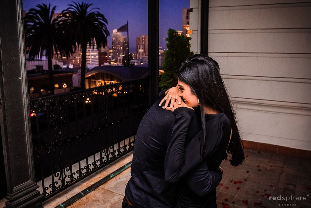 Sweet moment between couple on balcony