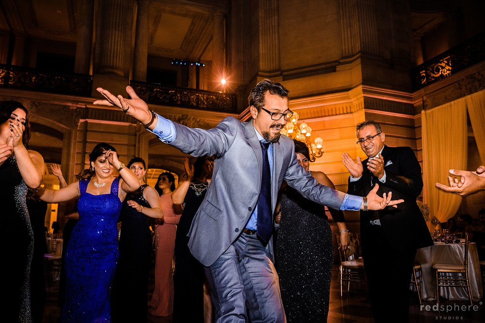 Guests dancing at wedding reception San Francisco City Hall