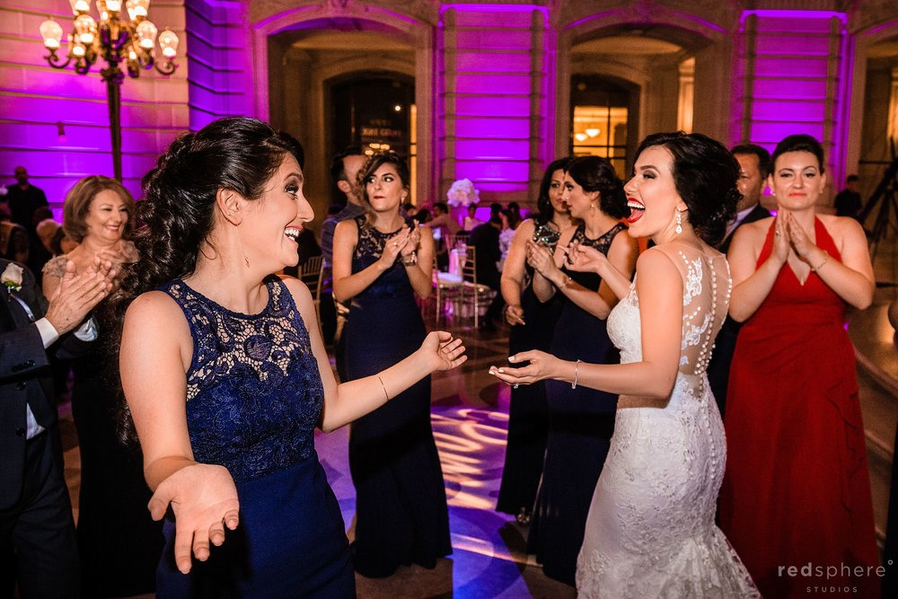 Bride dancing with a guest at San Francisco City Hall dance floor