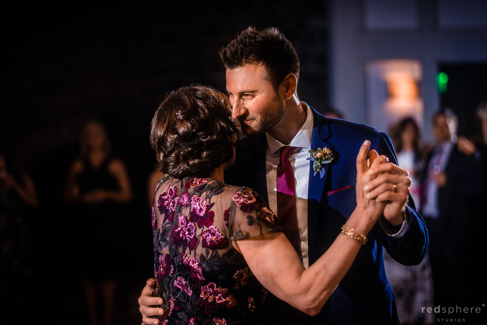 Emotional mother and groom dance at wedding reception. Harvest Inn By Charlie Palmer, St. Helena, Napa Valley