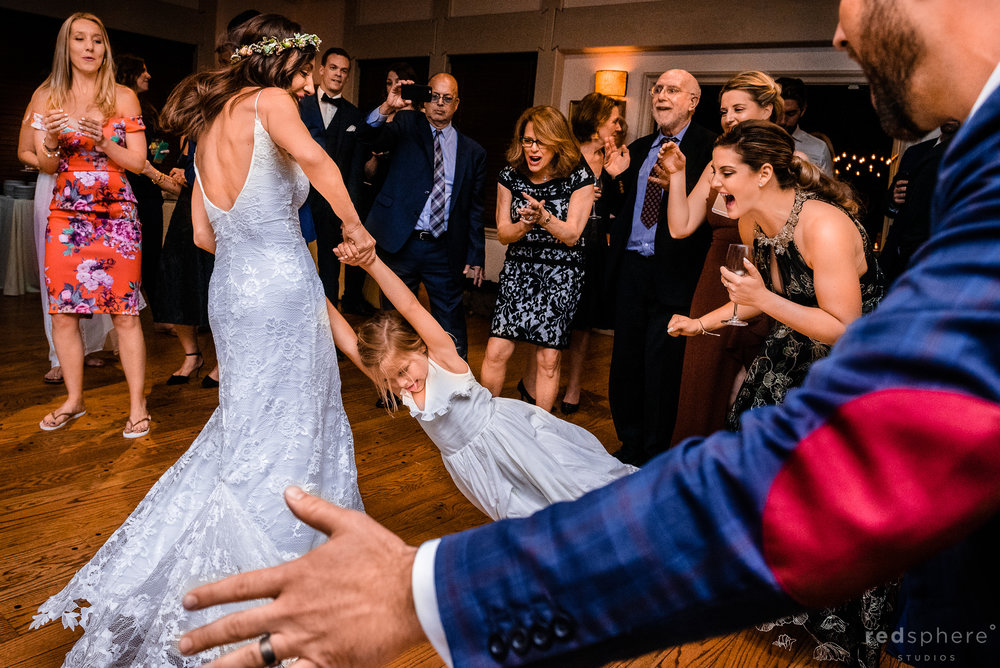 Friends and Family Having Fun. Wedding guests dancing during a wedding reception at Harvest Inn By Charlie Palmer, St. Helena, Napa Valley