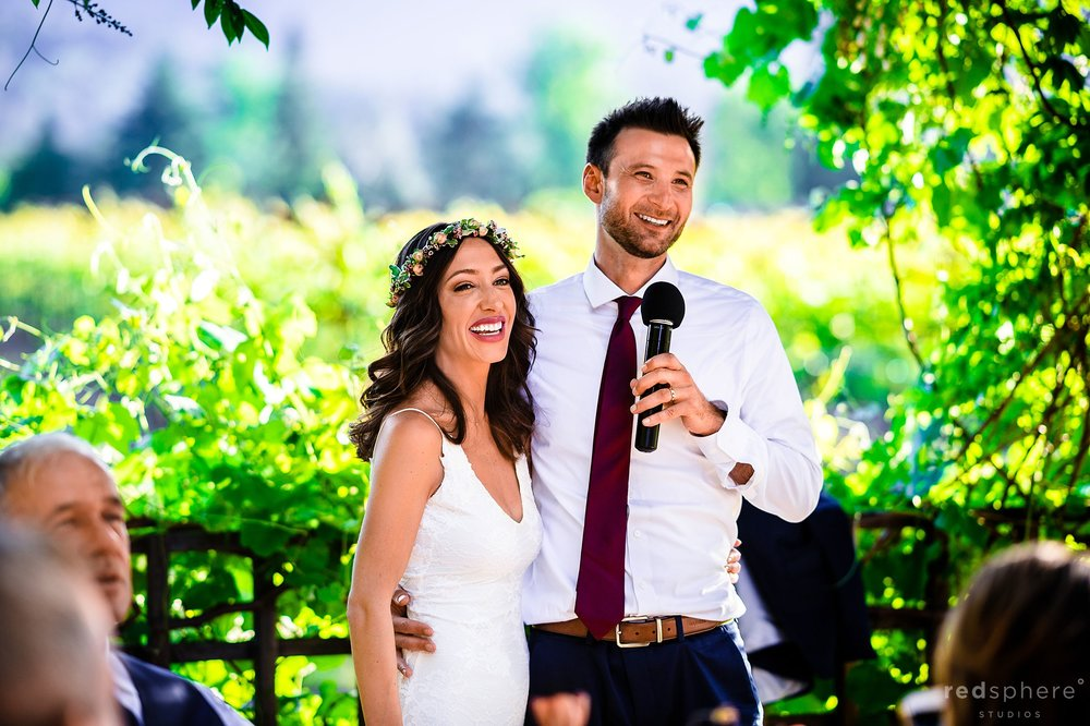 Wedding guests toasting bride and groom. Harvest Inn By Charlie Palmer, St. Helena, Napa Valley. Dress: Grace Loves Lace