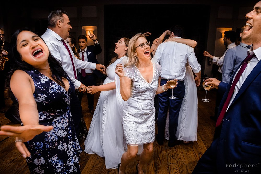 Bride and groom with guests on dance floor at Harvest Inn By Charlie Palmer, St. Helena, Napa Valley