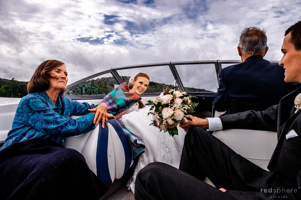 Bride and Groom Alongside Family on Boat at Saranac Lake New York