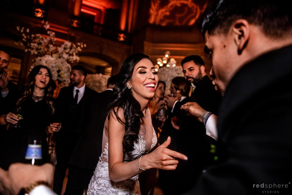 Bride and groom dancing with guests at San Francisco City Hall