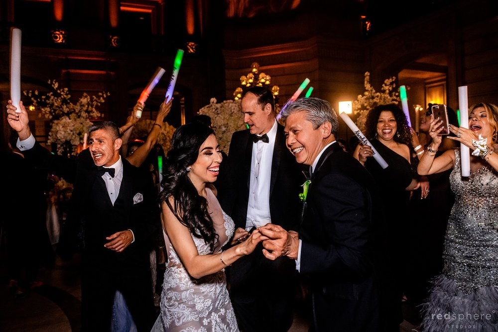 Bride dancing with father and guests at San Francisco City Hall dance floor