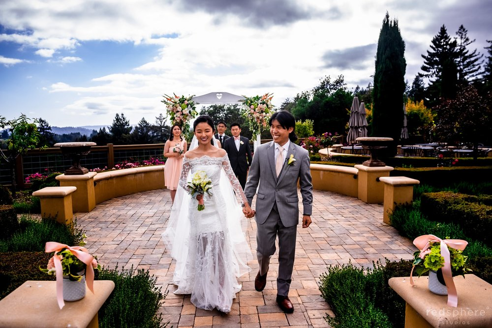 regale winery wedding ceremony walking down the aisle together as newlyweds