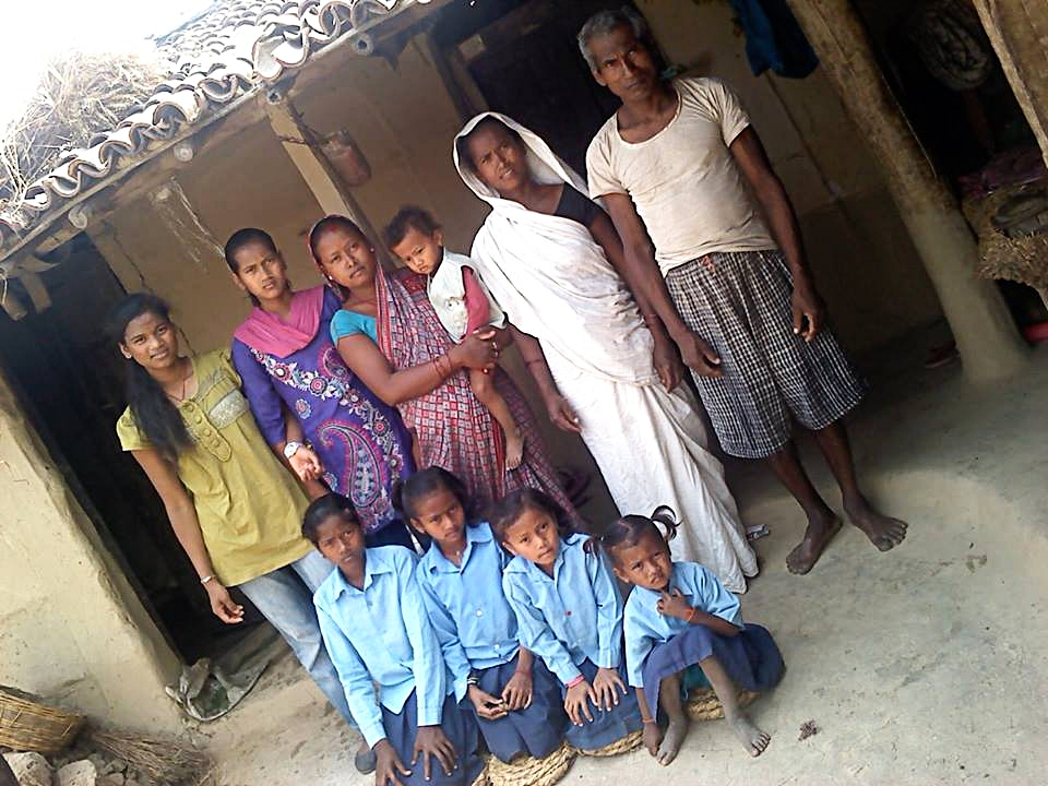 The Chaudhary Family.  Siru (far left) with her aunt and uncle, sisters and cousins.  All living in this humble little home.  The four girls at the front: Usha, Roshani, Reshma and Shivadata.  The young boy has a heart condition, his medical treatment is also covered by Yoga For The Soul Retreats.