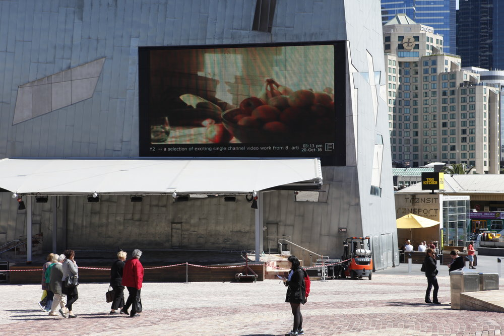 PLAY2, installation view at Federation Square, Nova Paul,  Still light , 2015, 16mm transferred to HD video, 6m 35s
