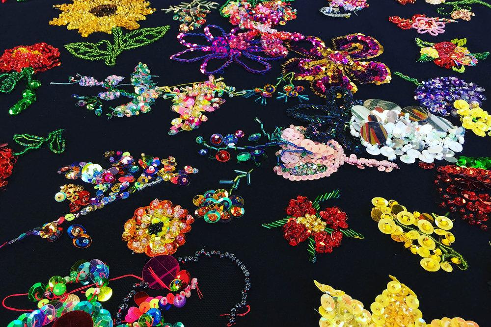 Participator community embroidery, Thoughts and Prayers -  Facilitated by Liam Benson ,  2015 – ongoing, glass seed and bugle beads, sequins, cotton, tulle, 135 x 135cm. Courtesy the artists and Artereal Gallery, Sydney. Photograph Liam Benson.