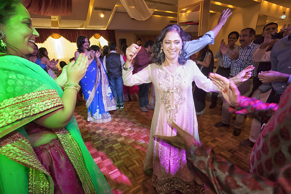 The mother of the groom celebrating at the sangeet
