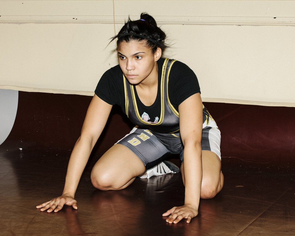 Andreina Rodriguez at wrestling practice, Grover Cleveland High School, Queens, NY. By Laurel Golio.