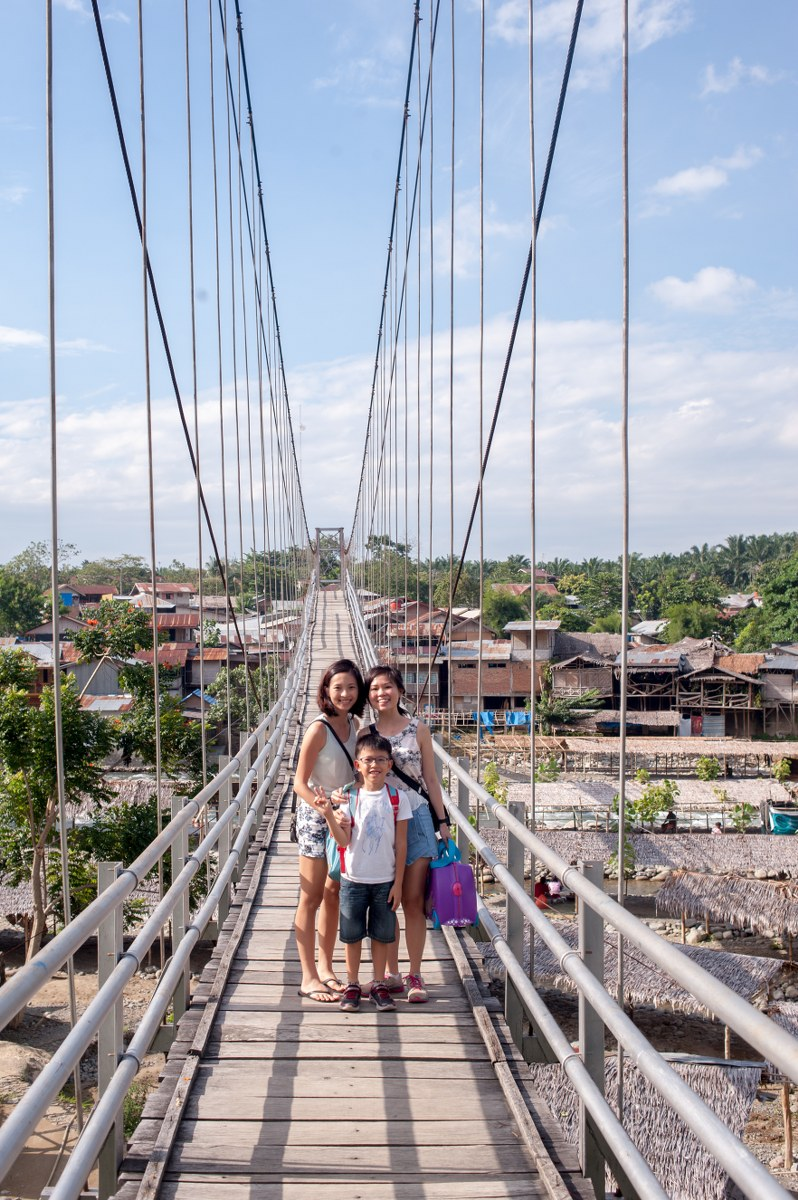 Some of these city kids probably have never crossed a suspension bridge before. The tree top walk is actually higher, but the few missing wooden planks on this bridge make the walk a bit more interesting.
