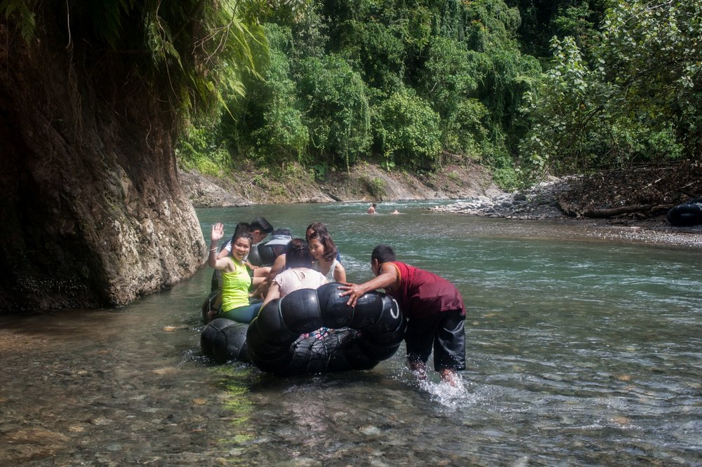 Tubing down the river after the trek.
