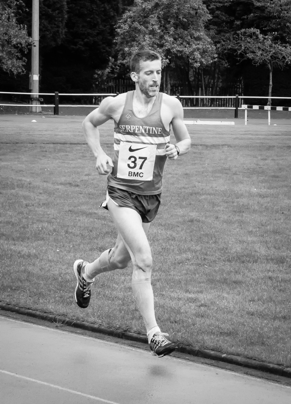 Running the Stretford 10,000 in 2014. I had a good race and finished in 32.00.01 -I was sure the clock was 31.59.99 when I crossed the line...