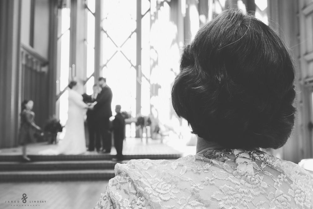 Mother of groom watching ceremony