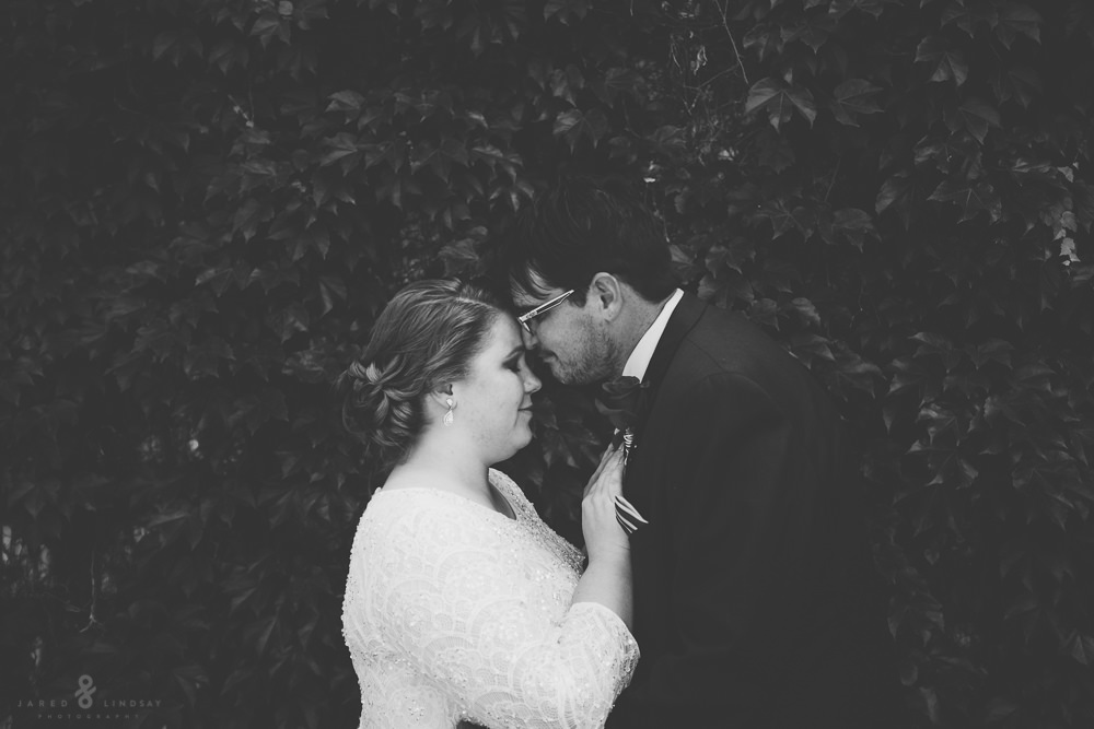 Photo of bride and groom standing face to face