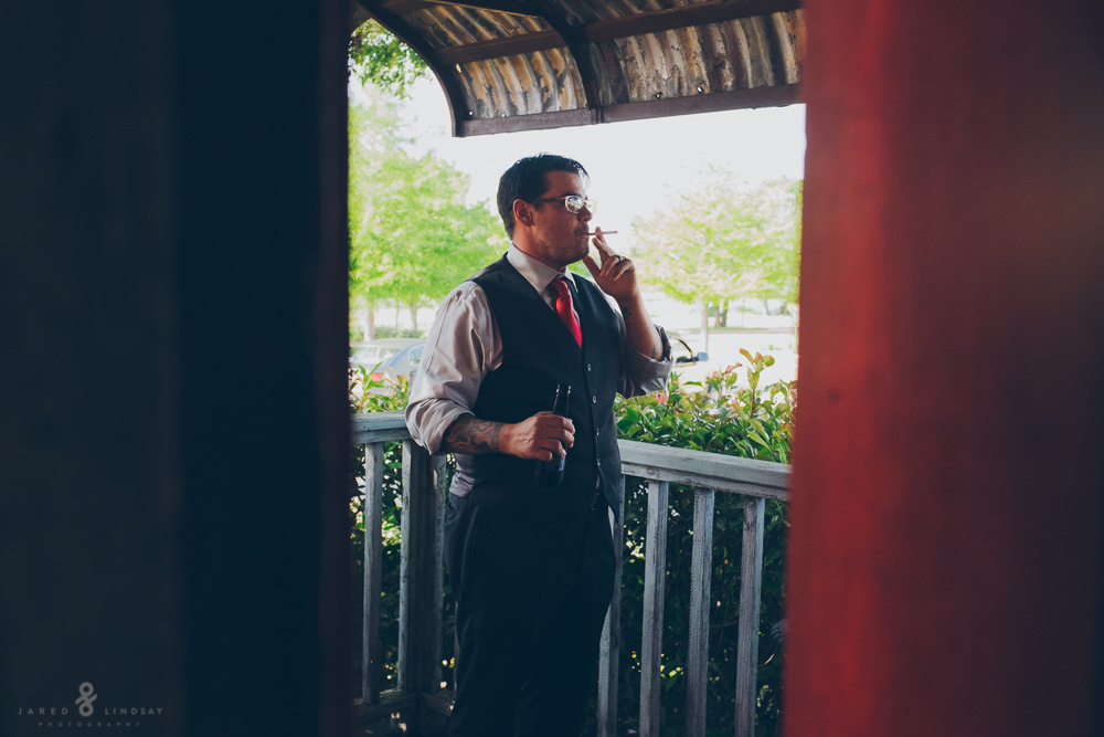 Groom smoking during wedding reception