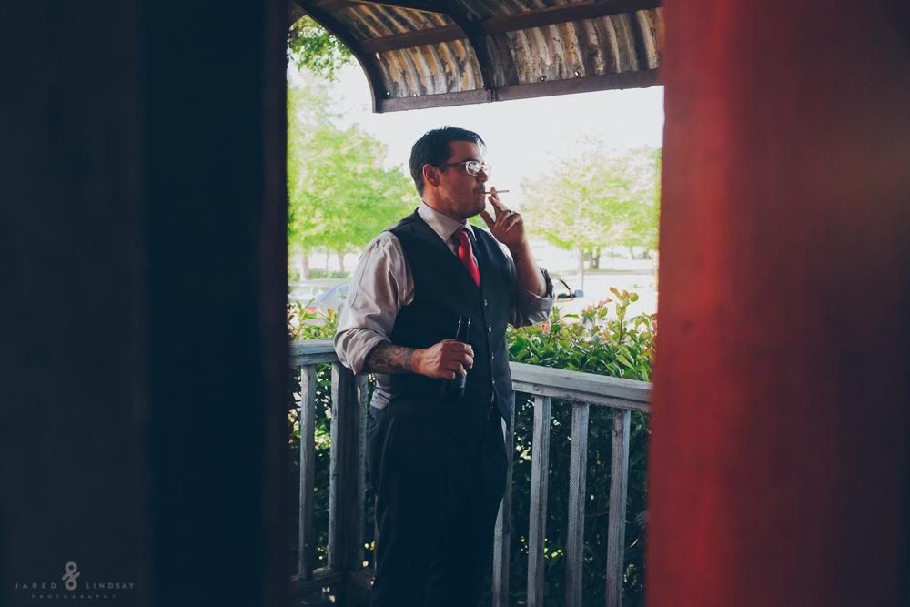 Groom smoking during wedding reception