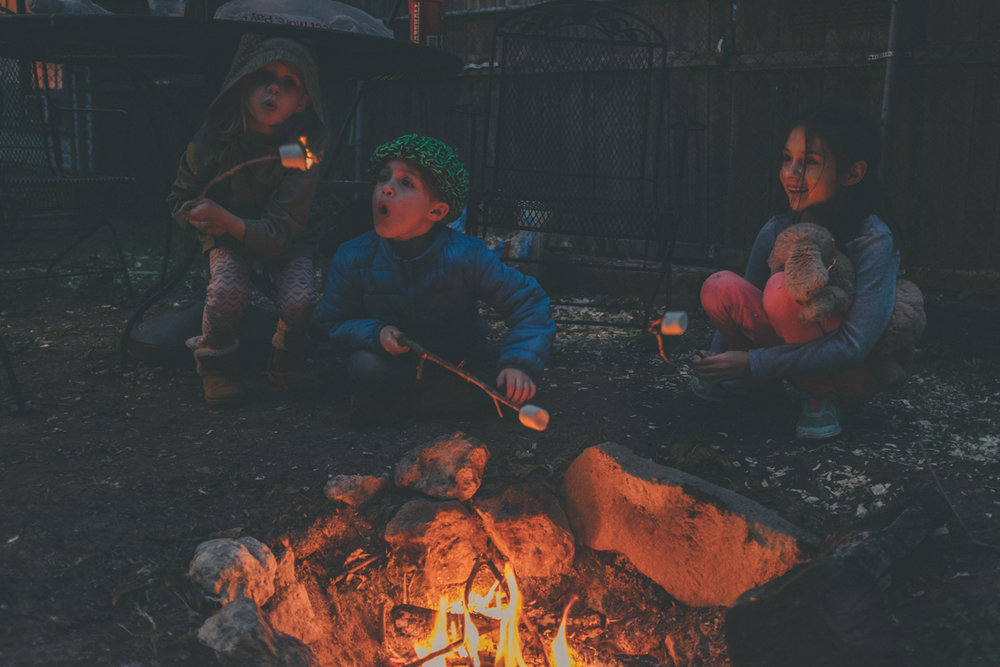 (Our babies, at our much used backyard fire pit)