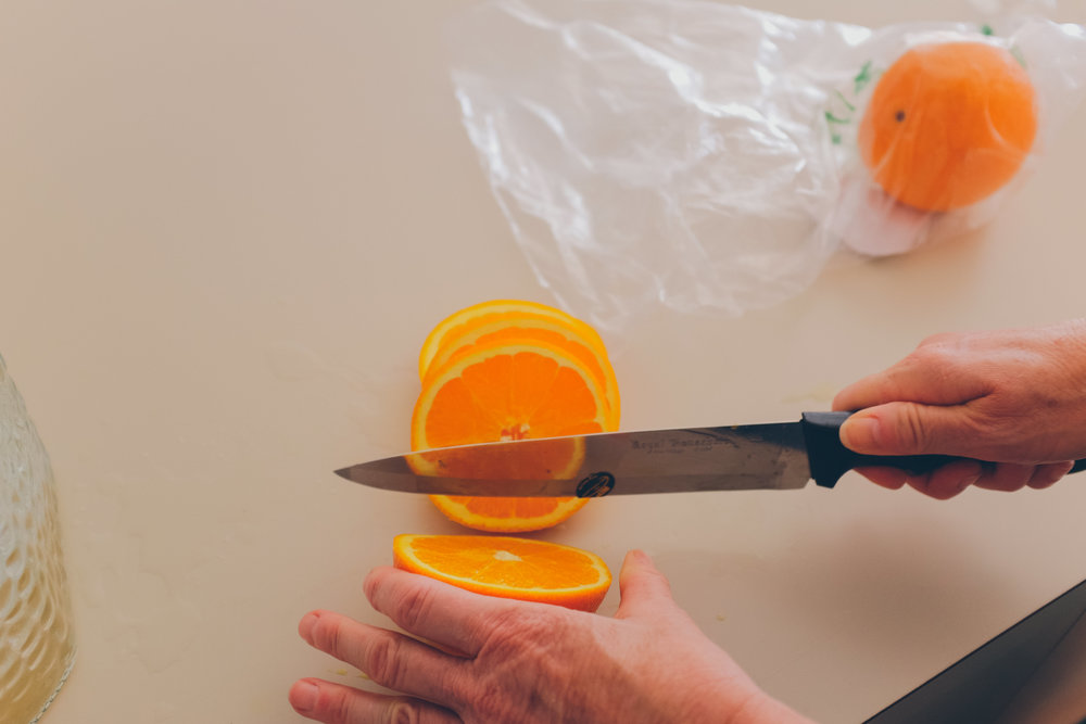 Cutting oranges with a knife