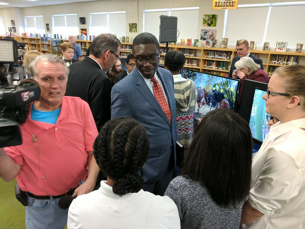 Dr. Shawn Joseph visits with students involved in the project and discusses with them what they are learning.