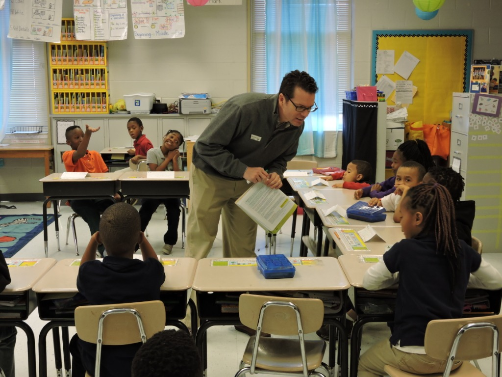 Brit Boatright of FirstBank Volunteers in a First Grade Classroom
