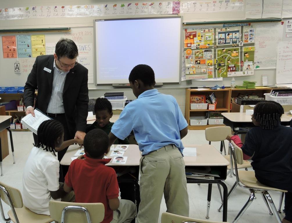Kyle Bazemore of Infiniti Volunteers in a Second Grade Classroom
