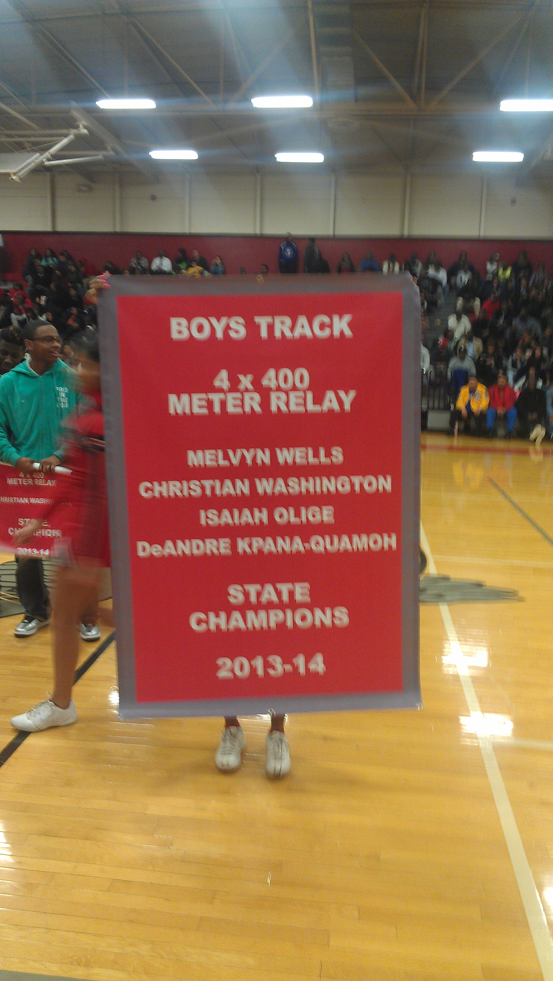 Banner ceremony at East Nashville for state champion relay team.
