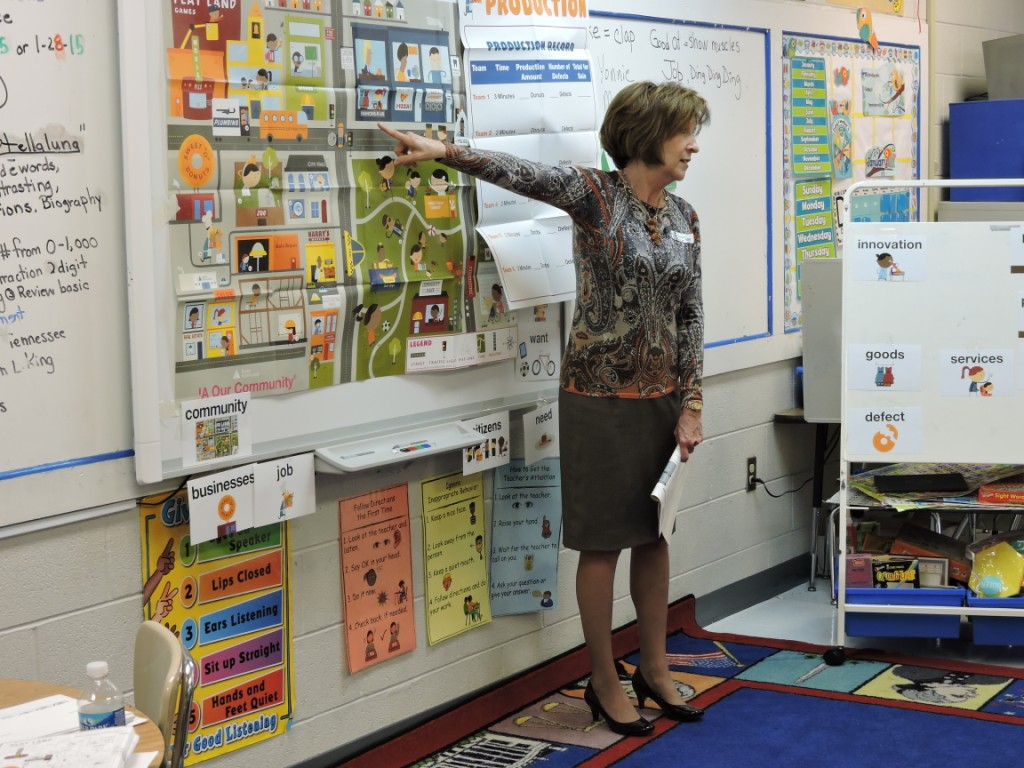 Yonnie Chesley of H2U Volunteers in a Second Grade Classroom