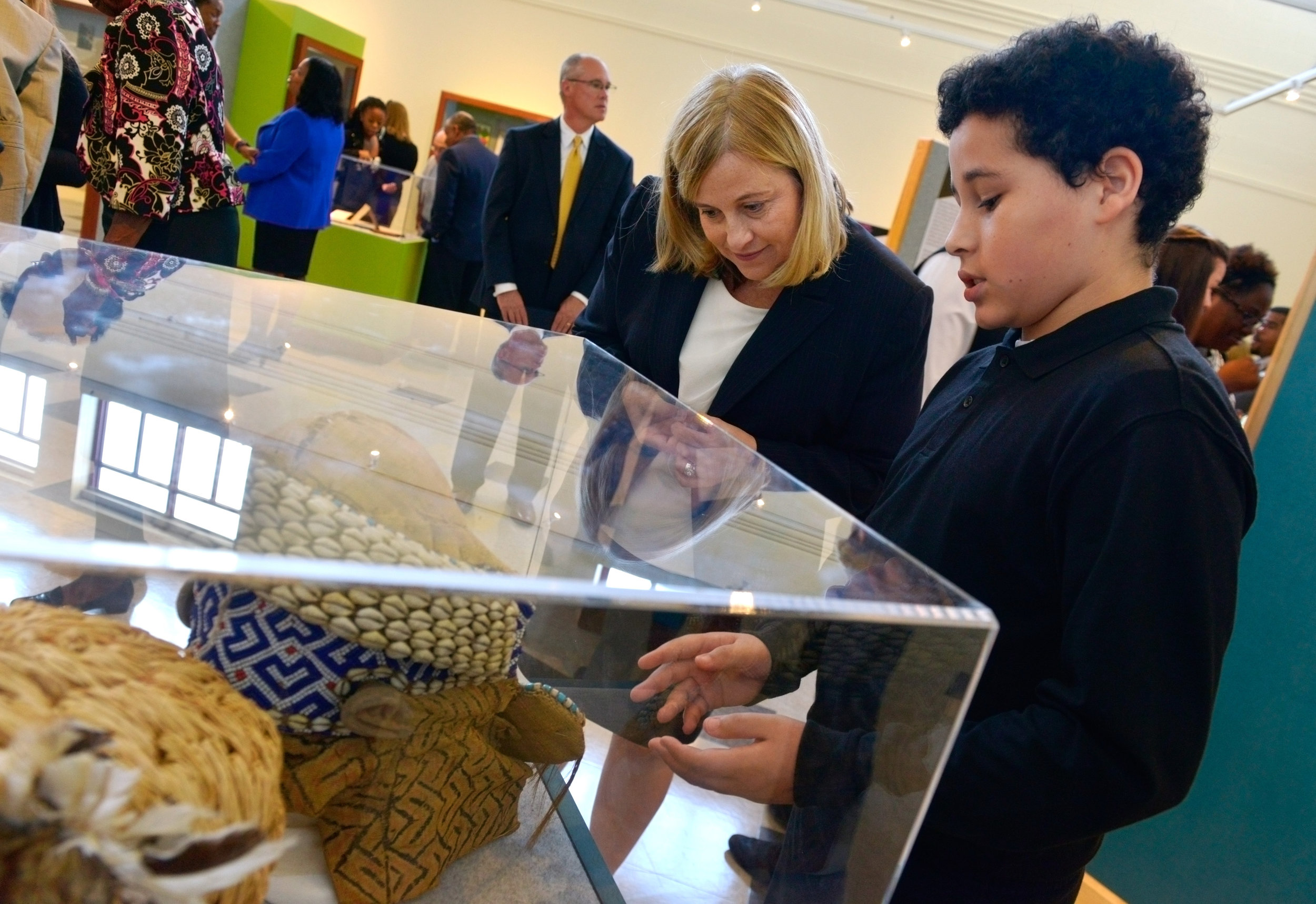 Mayor Megan Barry is given an explanation of an exhibit by a student at John Early Museum Magnet after a ribbon-cutting October 22, 2015 in Nashville, Tenn.