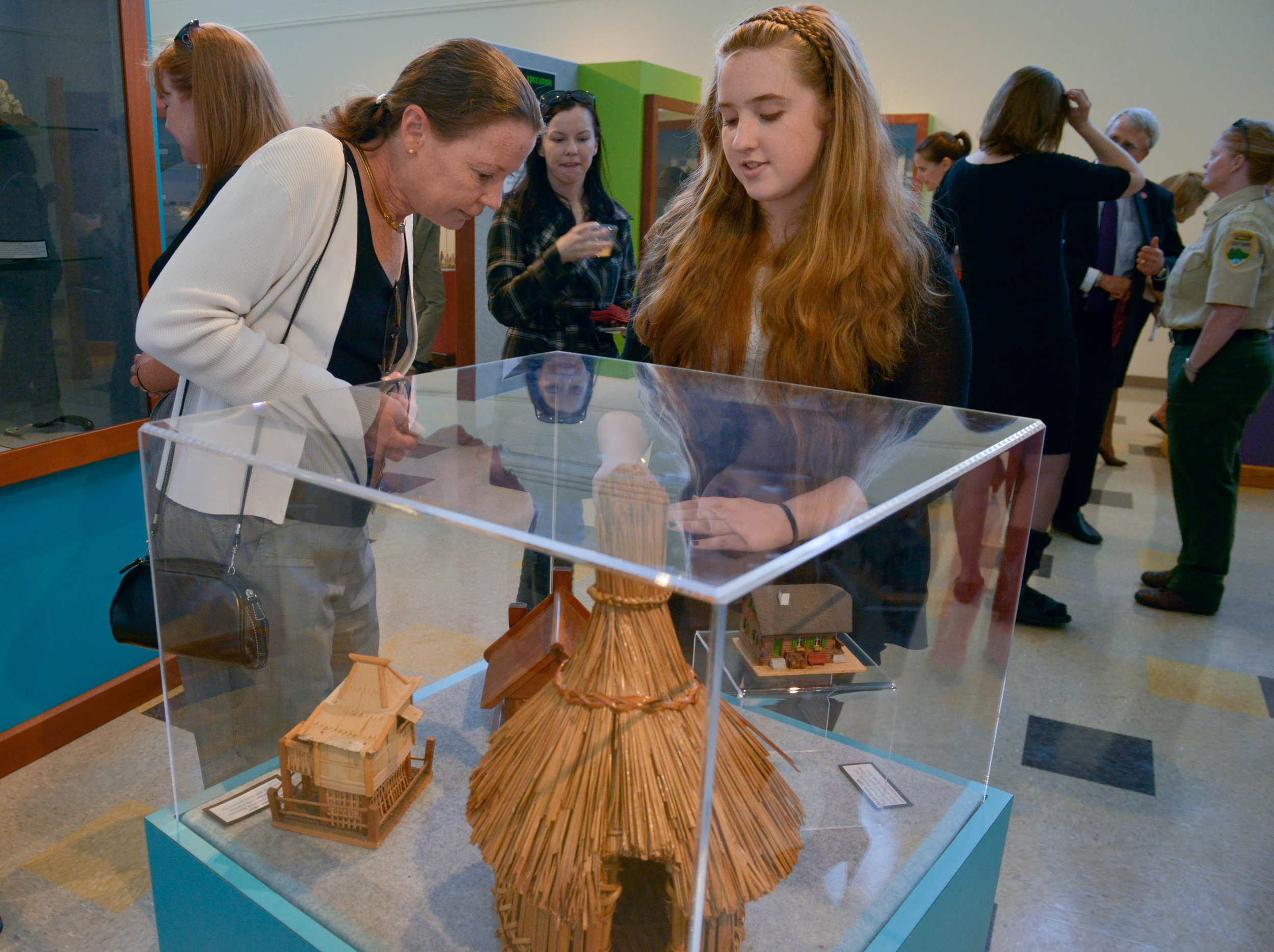 Davina Dunlap, a student at John Early Museum Magnet school explains an exhibit to Tia Wheeler at a ribbon-cutting celebration October 22, 2015 in Nashville, Tenn.