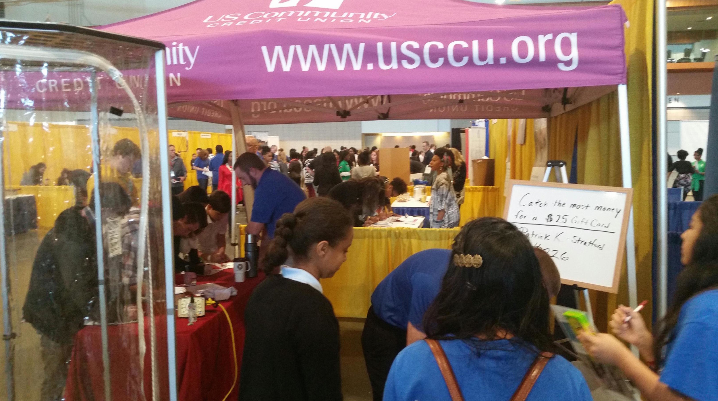 The US Community Credit Union booth had an interactive exhibit where students could catch as much fake money as they could for a $25 gift card. Students also interviewed USCCU staff to learn about financial careers.