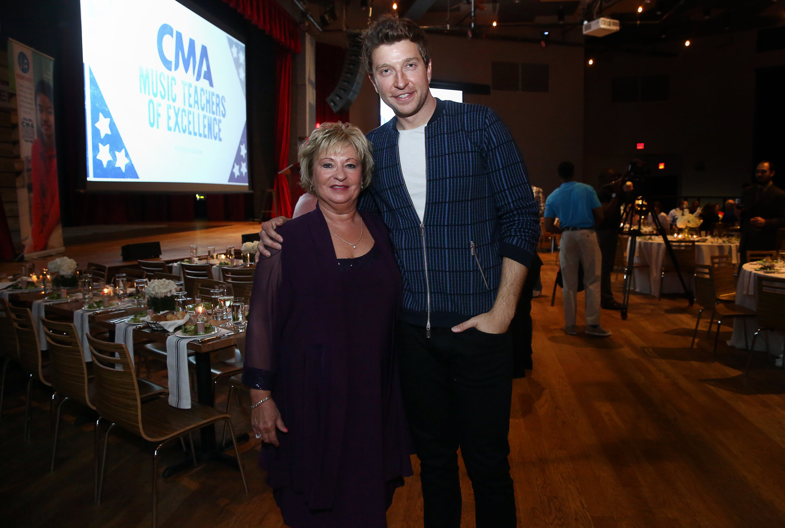 Brett Eldredge, host of the CMA Music Teacher of Excellence, welcomes his own childhood music teacher, Judy Carroll, as his special guest at the inaugural honors evening at City Winery Tuesday in Nashville. Photo Credit: Kayla Schoen / CMA