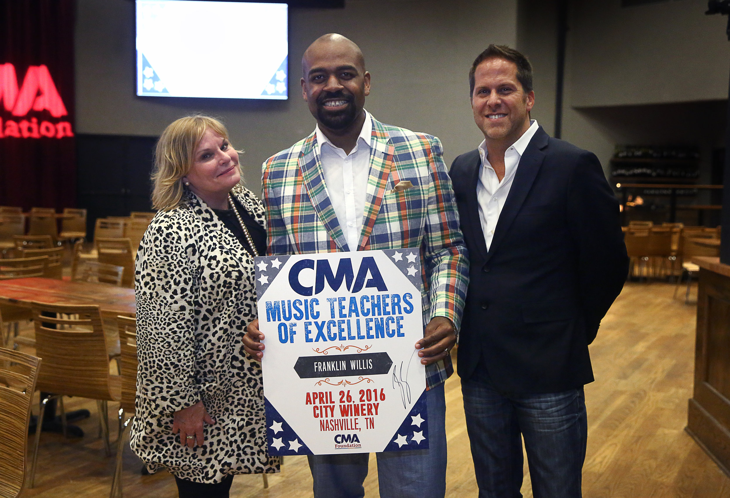 CMA Music Teacher of Excellence Franklin Willis, Choral Director at Madison Middle Prep (center), with Dr. Nola Jones, Coordinator of Visual and Performing Arts, Metro Nashville Public Schools, and Jon Loba, Executive Vice President, BBR Music Group and CMA Board member, at the CMA Music Teacher of Excellence honors at City Winery Tuesday in Nashville. Photo Credit: Kayla Schoen / CMA