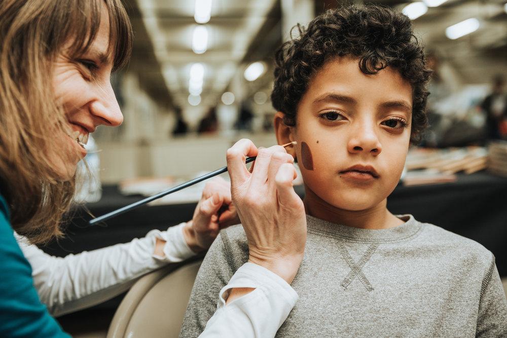 Boy getting Facepainted